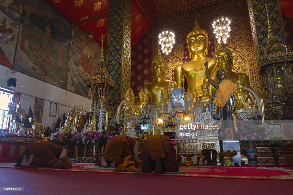 Monks paying respect to Lord Buddha : Stock Photo