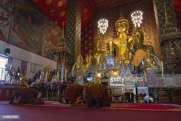 Monks paying respect to Lord Buddha