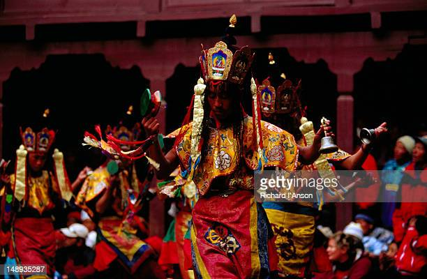 monks performing lama dance at mani rimdu festival. - mani rimdu festival stock pictures, royalty-free photos & images