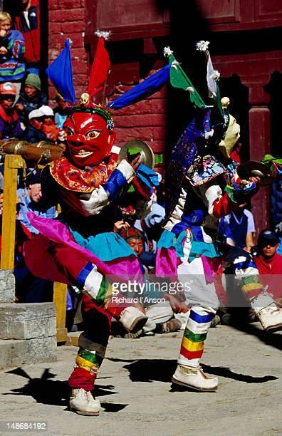 monks performing masked lama dance at mani rimdu festival. - mani rimdu festival stock pictures, royalty-free photos & images