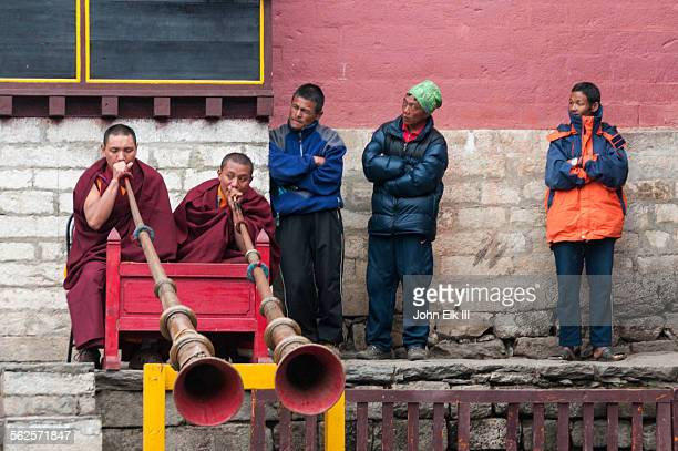 monks playing giant trumpets - mani rimdu festival stock pictures, royalty-free photos & images