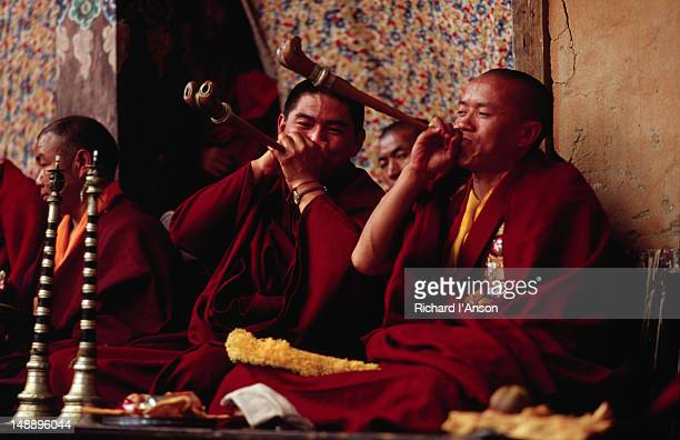 monks playing horns made of bone at the mani rimdu festival at chiwang gompa (monastery). - mani rimdu festival stock pictures, royalty-free photos & images