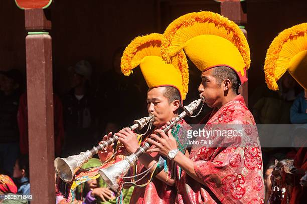 monks playing tibetan trumpets - mani rimdu festival stock pictures, royalty-free photos & images