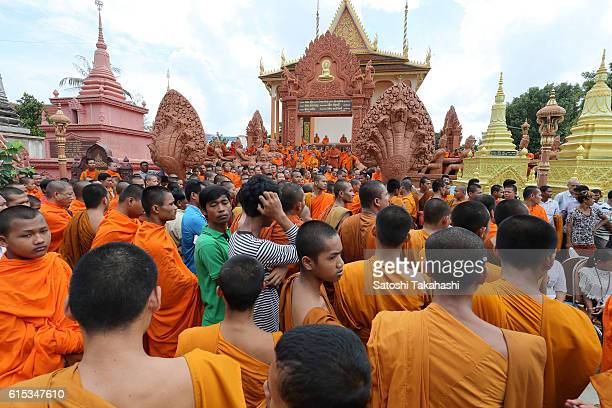 Monks prepare to ask for alms during the 100day funeral ceremony for prominent political analyst Kem Ley who was shot dead at Caltex convenience...
