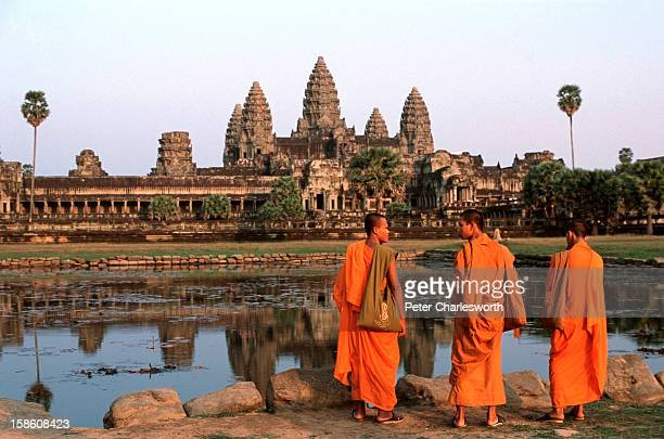 Monks prepare to watch the sunset at the main temple of Angkor Wat