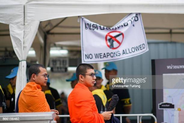 Monks queue at the security gate to attend the funeral of the late Thai King Bhumibol Adulyadej on October 25 2017 in Bangkok Thailand The funeral of...