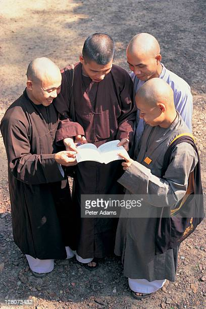 monks reading book, hue, vietnam - peter adams stock pictures, royalty-free photos & images