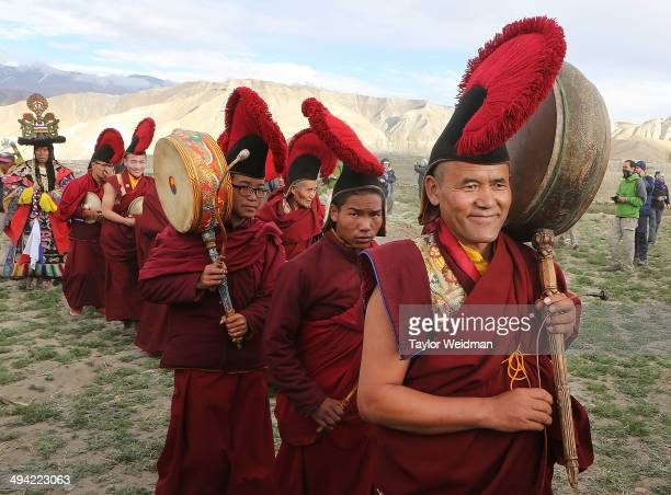 Monks return to the city after performing ceremonies in a nearby field during the Tenchi Festival on May 27 2014 in Lo Manthang Nepal The Tenchi...
