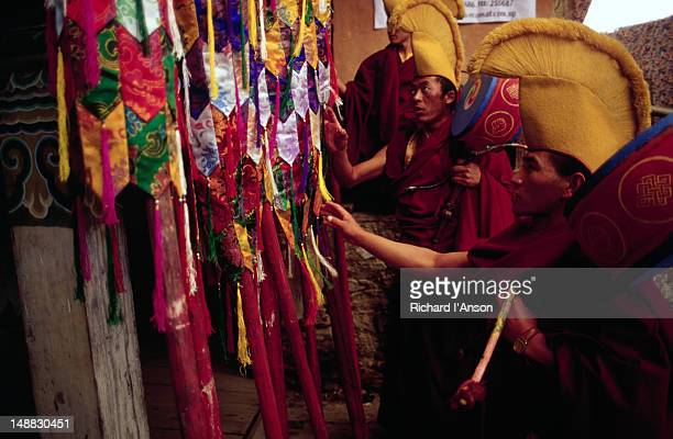 monks selecting ceremonial banners for use in the mani rimdu festival at chiwang gompa (monastery). - mani rimdu festival stock pictures, royalty-free photos & images