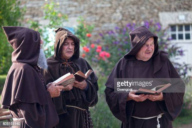 monks singing in choir - monk stock pictures, royalty-free photos & images