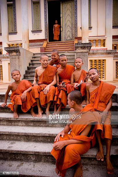 CONTENT] Monks sitting in front of an old monastery Wat Slaket in Battambang Cambodia