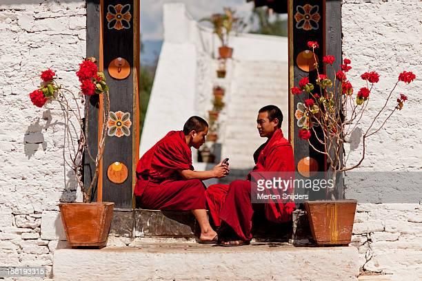 Monks sitting in Punakha Dzong doorway