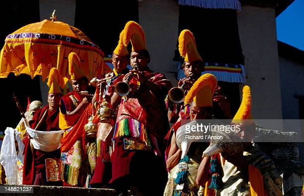 monks sounding horn and conch shell at mani rimdu festival. - mani rimdu festival stock pictures, royalty-free photos & images