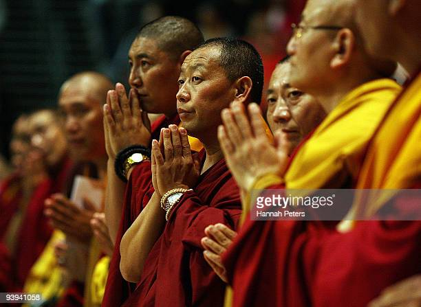 Monks stand for His Holiness the 14th Dalai Lama to arrive at the Vector Arena on December 5 2009 in Auckland New Zealand His Holiness the 14th Dalai...