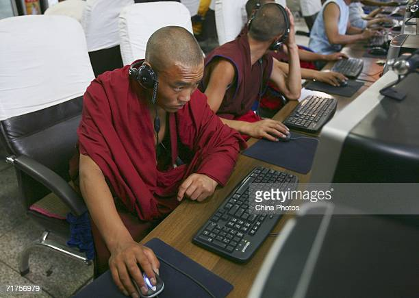 Monks surf the net at an internet cafe on August 30 2006 in Lhasa of Tibet Autonomous Region China There has been an increase in Chinese tourists...