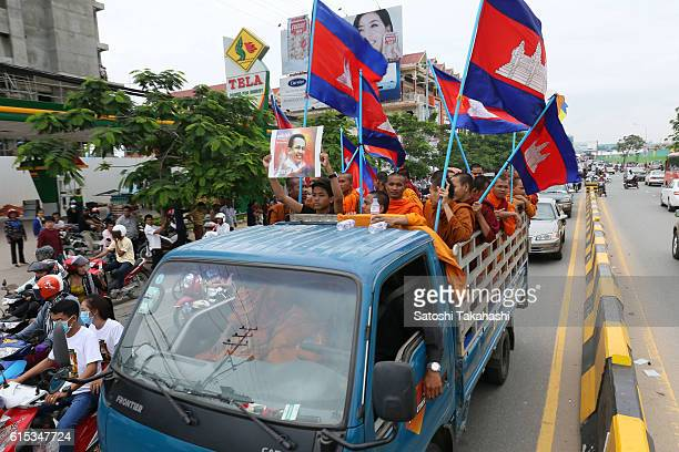 Monks take part in a funeral procession for slain prominent political analyst Kem Ley to mark 100 days since his deathThey make their way to Ley's...