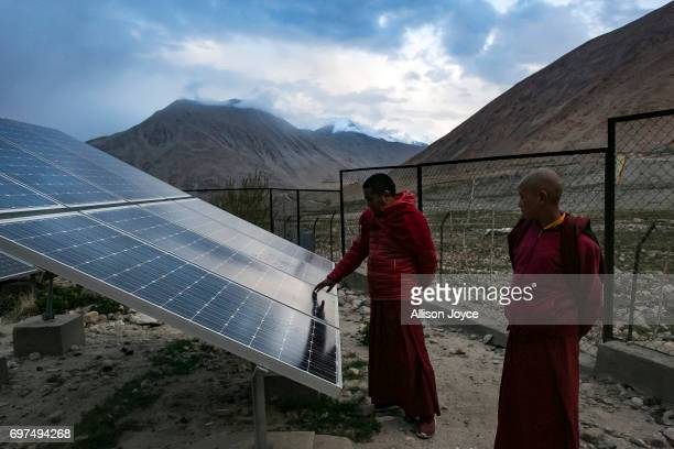 Monks touch solar panels at the Shachukul Monastery of which the dormitory and school are reliant on solar energy in Chosling village on June 13 2017...