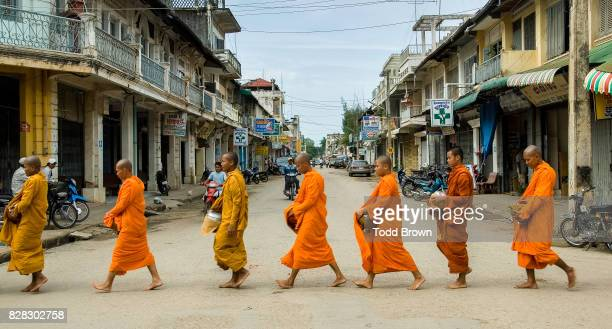 Monks walk in line for alms in Battambang