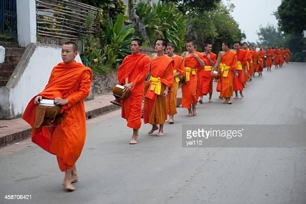 Monks walking on a street