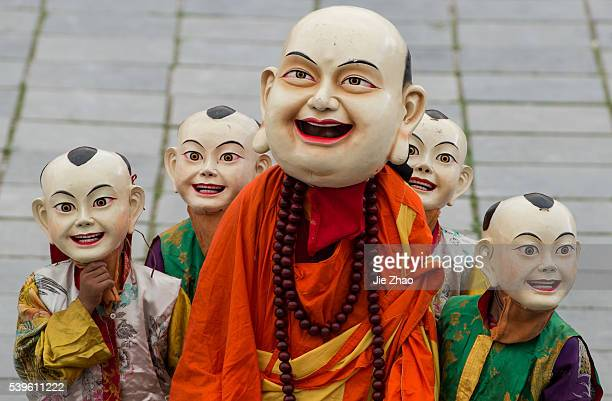 Monks with mask dance at a pilgrimage fair at Paoma Mountain in Kangding of Ganzi Tibetan Autonomous Prefecture southwest China's Sichuan Province...
