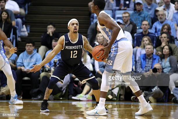 Monmouth's Justin Robinson guards North Carolina's Seventh Woods The University of North Carolina Tar Heels hosted the Monmouth University Hawks on...