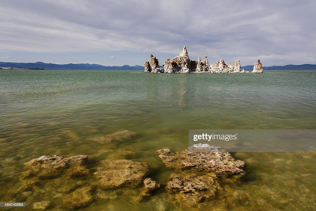 Mono Lake tufa rock in green water : Stock Photo