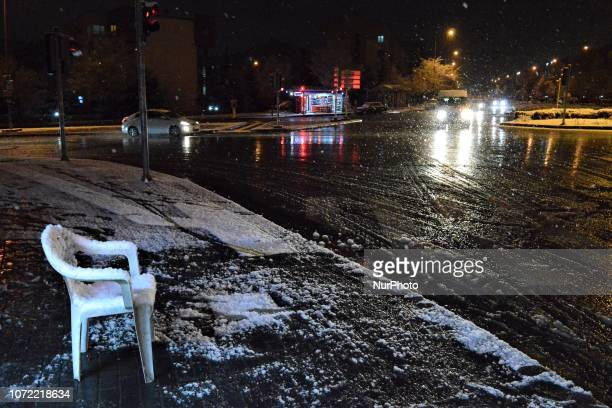 A Monobloc chair covered in a blanket of snow is placed near an intersection during a heavy snowfall in the winter season in Ankara Turkey on...