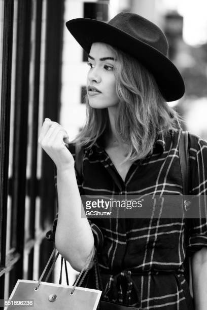 Monochromatic image of a cute girl window shopping