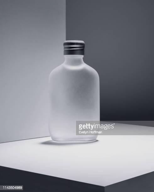 monochromatic still life with bottle - concetti e temi foto e immagini stock