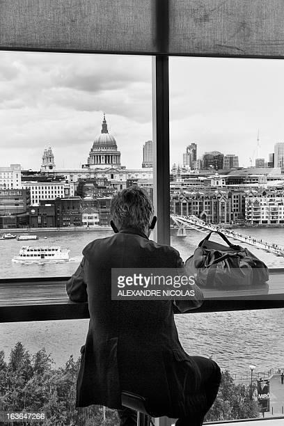 Monochrome b&w black and white man back sitted london pantheon overview thames bag sad melancholic