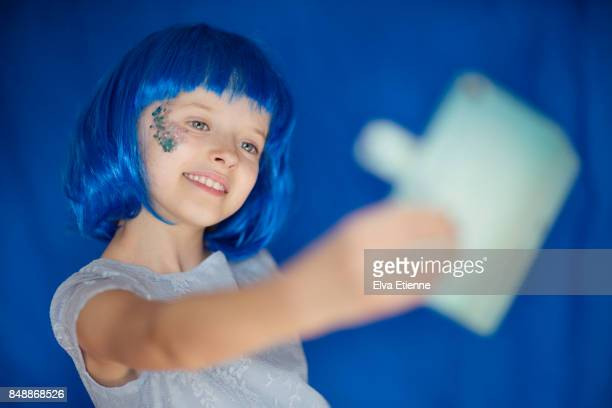 monochrome color - blue hair stock pictures, royalty-free photos & images