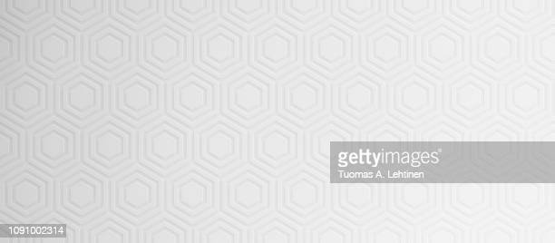 Monochrome geometric pattern of big hexagons. Simple abstract background. Slight lightness gradient.