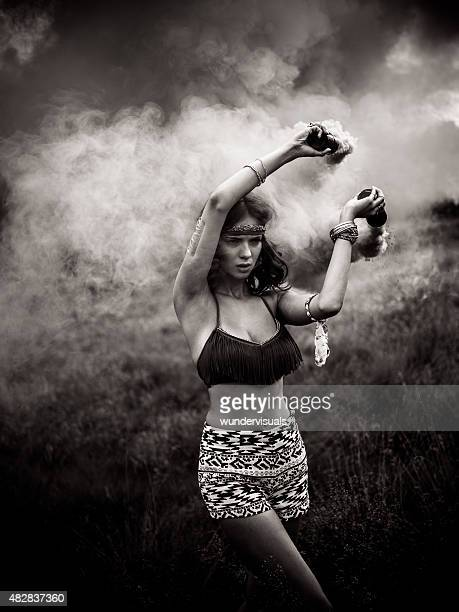 Monochrome image of a girl with smoke in a park