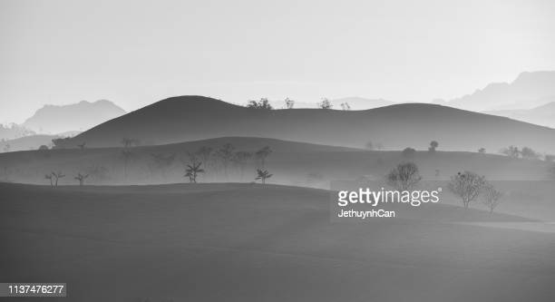 monochrome landscape of layered mountains and hill - son la province stock pictures, royalty-free photos & images