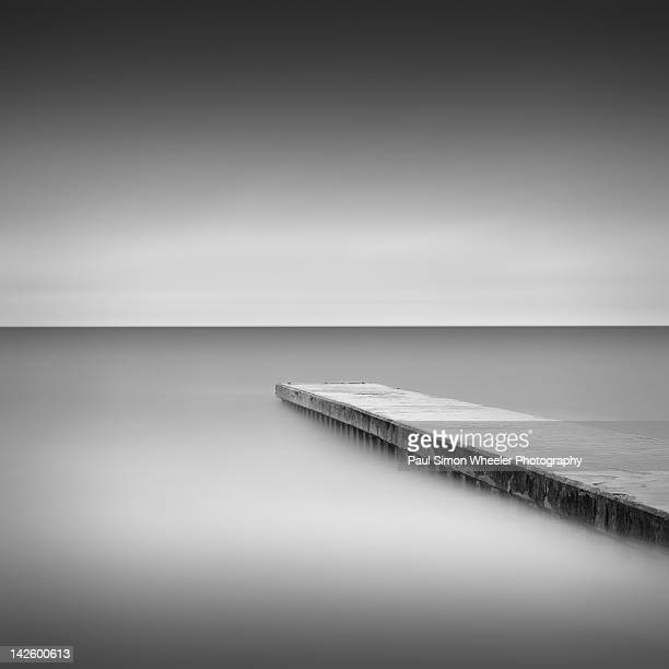 monochrome long exposure jetty, blyth uk - blyth northumberland stock pictures, royalty-free photos & images