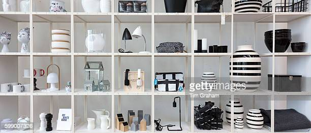 Monochrome shelf display of black and white gifts souvenirs baskets storage vases in shop Arken Museum of Modern Art on June 24 2015 near Copenhagen...