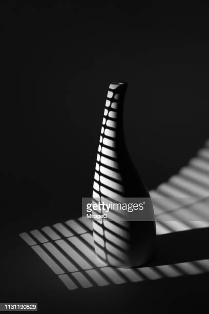 monochrome stripe pattern light casting vase - miragec stock pictures, royalty-free photos & images