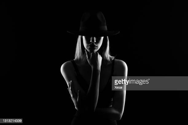 monochrome studio shot of young beautiful woman wearing hat - 2018 stock pictures, royalty-free photos & images