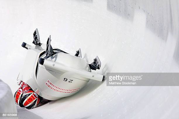 Monoco 1, piloted by Patrice Servelle, crashes in the third run of the the four man competition during the FIBT Bobsled World Championships at the...