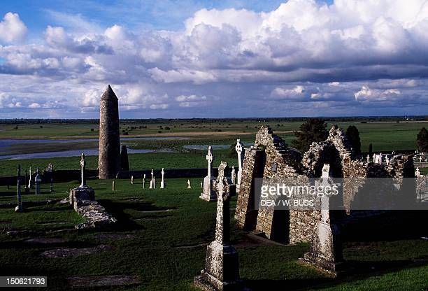Monolithic high crosses and O'Rourke's Tower in the monastic complex on the banks of the River Shannon Clonmacnoise Ireland