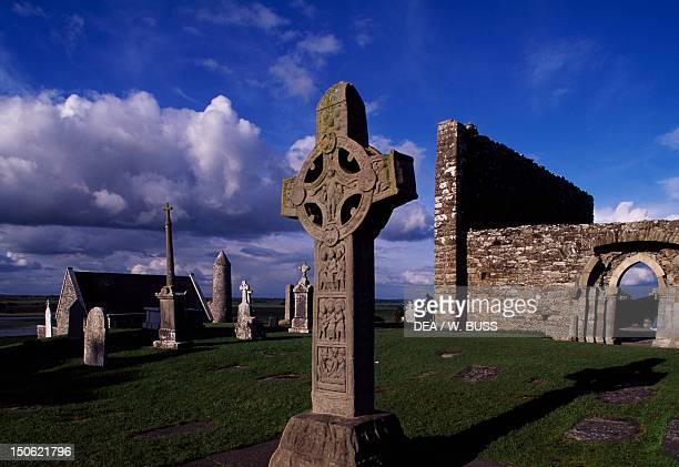 Monolithic high crosses and ruins of the cathedral in the monastic complex on the banks of the River Shannon Clonmacnoise Ireland