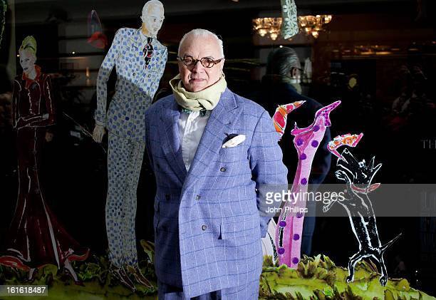 Monolo Blahnik poses for photos in front of fashion windows designed by him for Fashion Week at The May Fair Hotel on February 13 2013 in London...