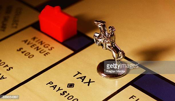 Monopoly board game with a piece stopped on 'Tax' 6 April 1998 AFR Picture by JESSICA HROMAS