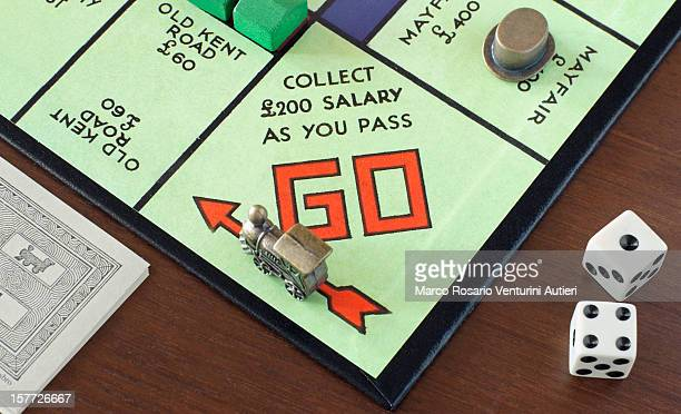 monopoly's go! - wages stock pictures, royalty-free photos & images