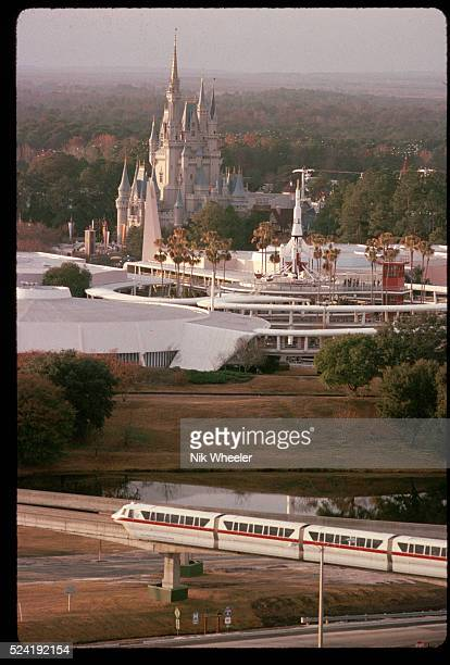 Monorail heads toward Cinderella's Castle and Space Mountain in Florida's Walt Disney World.