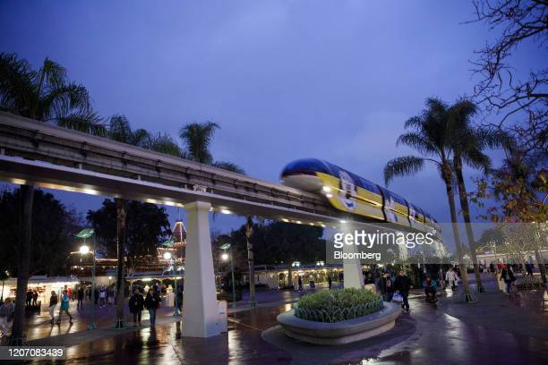 Monorail passes overhead as guests exit Walt Disney Co.'s Disneyland theme park in Anaheim, California, U.S., on Friday, March 13, 2020. Fans in...