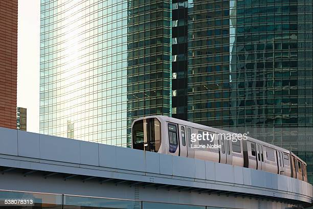 monorail passing skyscrapers - monorail stock pictures, royalty-free photos & images