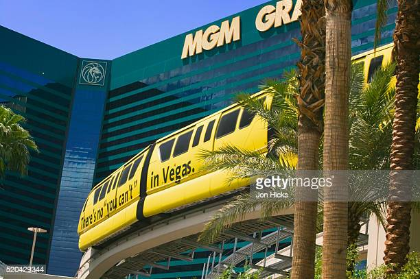 monorail passing the mgm grand - monorail stock pictures, royalty-free photos & images