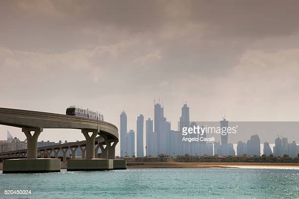monorail to atlantis hotel on palm jumeirah island - monorail stock pictures, royalty-free photos & images
