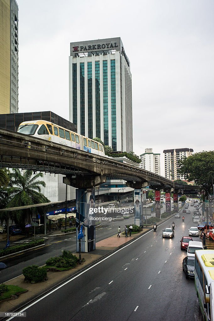 Monorail train moves along an elevated track as traffic passes underneath in Kuala Lumpur, Malaysia, on Thursday, April 25, 2013. Malaysians will go to the polls on May 5. Prime Minister Najib Razak's National Front coalition is seeking to extend its 55 years of unbroken rule in the face of a resurgent opposition led by Anwar Ibrahim. Photographer: Sanjit Das/Bloomberg via Getty Images